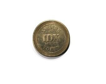 """vintage token arcade token x-mark """"IDX"""" token gaming coin goldtone by idx inc. EL Dorado, AR"""