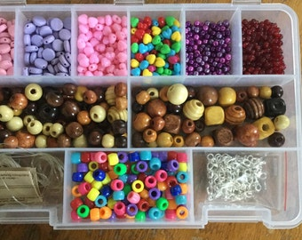 Set of beads with a plastic container