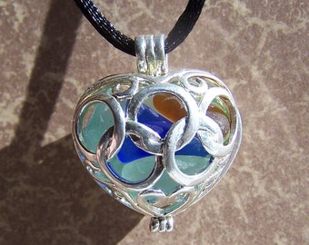 Necklace: HEART Silver with tinyEnglish Sea Glass  Plump, intertwined LOCKET opens. Blues, greens, gold.  Offers Considered.     22.00