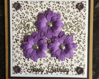 Purple Flowers with Black Buttons and Silver Flourishes Birthday Card