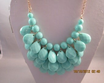 4 Row Bib Necklace with Blue/Green Teardrop Dangles on a Gold Chain
