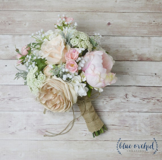 This boho bouquet has a mix of peonies and wildflowers. This silk flower bouquet has a beautiful mix of pink and neutral flowers mixed with greenery. If you are