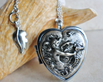 Music box locket,  heart shaped locket with music box inside, in silver with a mermaid and seahorse.