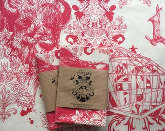 Screen printed tea towel featuring a Bull's head, drawings and damask patterns.