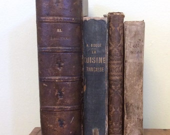 Four antique decorative books sold as a set