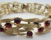 Lisner Signed Gold Tone Metal Bracelet with Red Ruby Like Stones