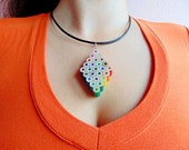 Diamond shaped rainbow colored pencil crayon necklace pendant with bri...