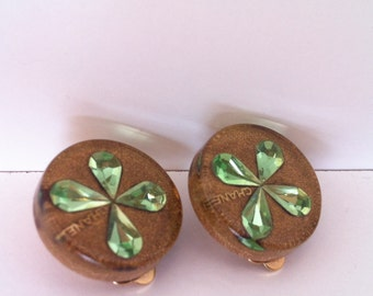 Vintage Chanel earrings with gold logo and green clover