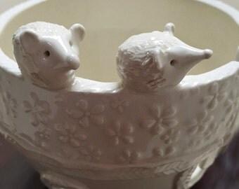 Hedgehog Porcelain Yarn Bowl wide base, indented rim, 2 yarn feeds. Strong and Lovable