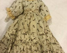 """Antique German China doll/12"""" tall with antique clothes"""