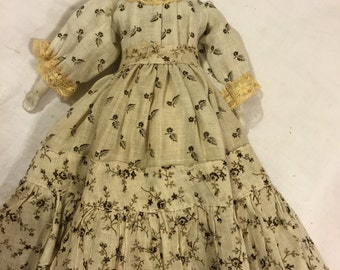 "Antique German China doll/12"" tall with antique clothes"