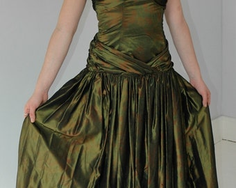Be a Grecian goddess in this 80's petrol green strapless dress with its drape design and boned bodice size 10