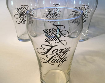 "Large ""Foxy Lady"" pint glass, holds 32 ounces – four may be available"