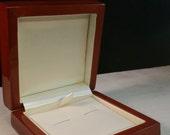 Cufflink box of Mahogany wooden veneer. Beautiful wooden veneer box which can hold a pair of mens cufflinks