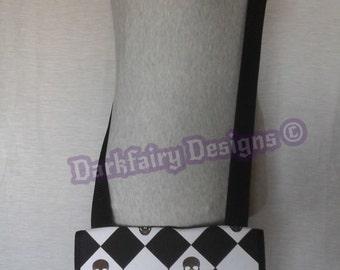 Harlequin skull design handbag