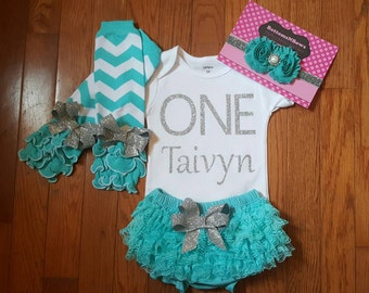 """Silver Glitter Vinyl """"ONE"""" with personalized name bodysuit, Aqua Lace Bloomers, Leg Warmers, and Headband set, cake smash set"""