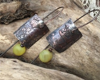 Earrings in copper wire and natural agate.