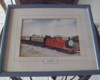 """1984 Vtg.glass-framed coloured print of """"JAMES """" the engine from the""""THOMAS the TANK engine & friends"""" series-Very good condition.One owner."""