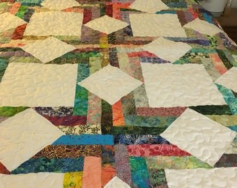 bright and coloful describe this queen size quilt mad with an assortment of different batik fabrics.