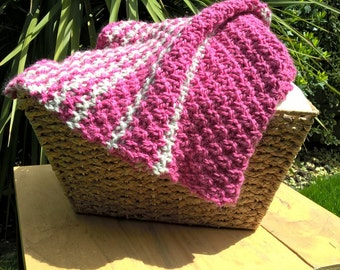 Pink and green knitted baby blanket