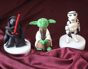 Star Wars Inspired Kylo-Ren, Yoda, and Storm Trooper, fondant cake toppers. Free light sabers included!!!