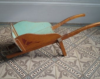 Old wheelbarrow for child form Butterfly