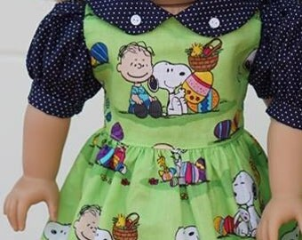 American girl doll  dress (snoopy or puppy pink) (dress only).