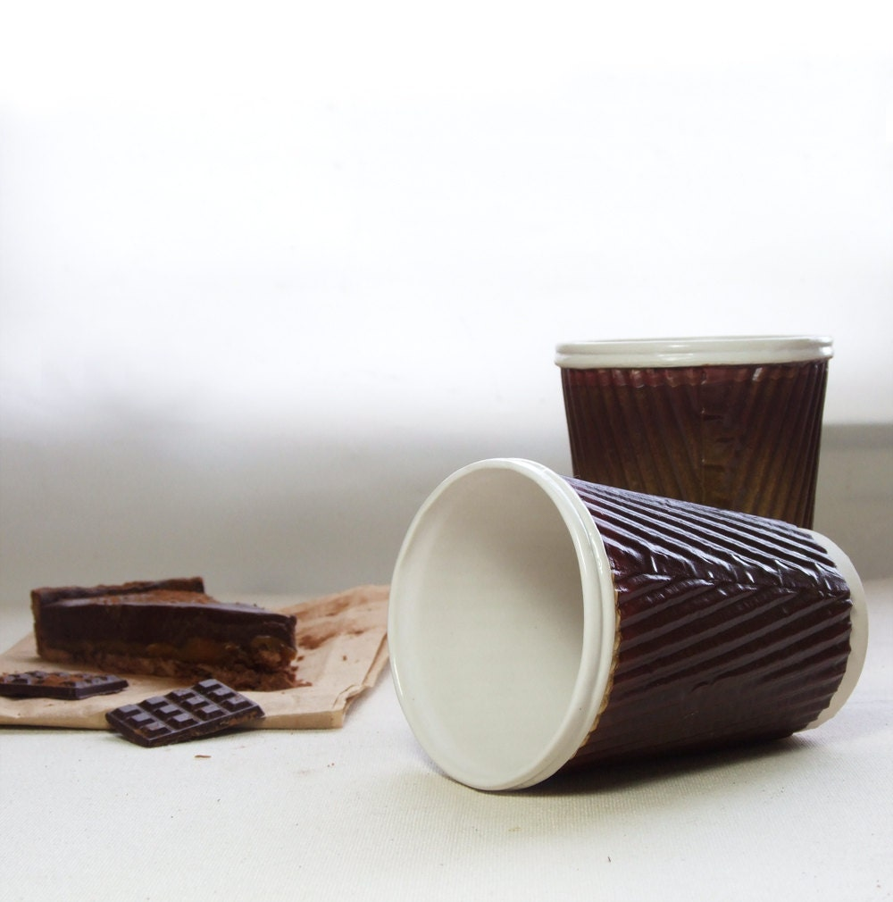 coffee cup or ceramic travel mug porcelain cup in chocolate