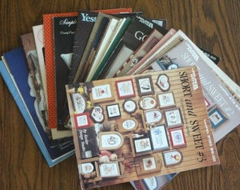 33 CROSS STITCH Charted DESIGNS Leaflets, Booklets      SP4*