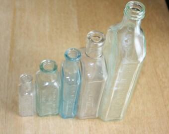 """Set of five """"medicine"""" bottles, vintage apothecary bottles"""