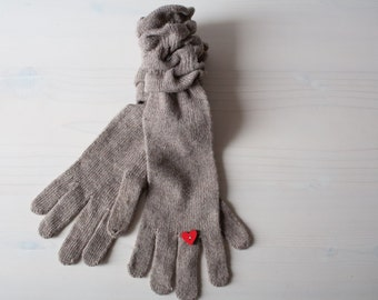 Gloves with red wooden heart