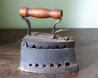 Fer de collection miniature du milieu du siècle.