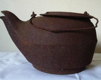 Vintage cast iron kettle