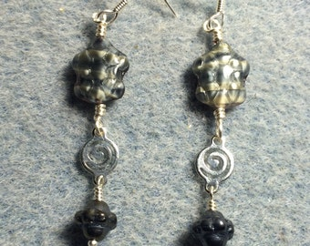 Grey blue marbled Czech glass turtle bead dangle earrings adorned with silver swirly connectors and metallic grey Saturn beads.