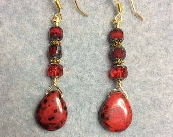 Bright red Czech glass briolette dangle earrings adorned with red Czech glass beads.