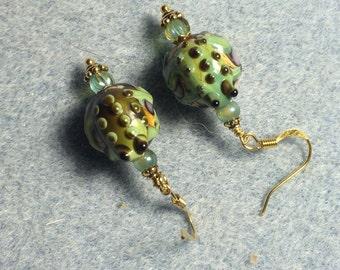 Green lampwork frog bead earrings adorned with green Czech glass beads.