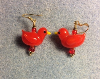Red lampwork duck bead earrings adorned with red Czech glass beads