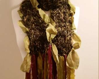 Hunter green, chartreuse,  burgundy hues. Hand knit scarf with dyed silk on sides and ends. Soft, warm with added texture - 3 yarn blend.