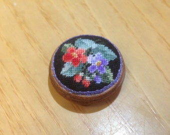 Mini footstool with embroidered bouquet