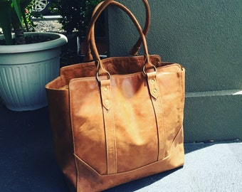 Timeless handmade classic,traditional shoulder Tote Bag. Quality stitching and leather. Strong handles and fully lined inside.