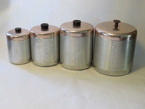 set of vintage silver and copper kitchen canisters flour