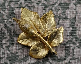 gold finish rose brooch