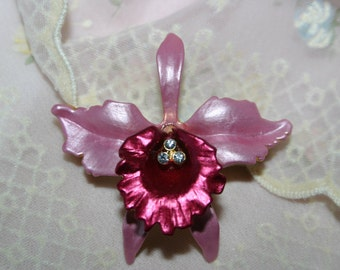 Vintage pin/brooch.  Pink and plum enamel orchid with clear rhinestone center.  Matte brushed finish
