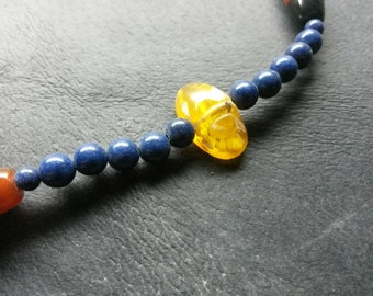 Hand carved Baltic amber Egyptian scarabeo Beatle with lapis lazuli and carnelian beads