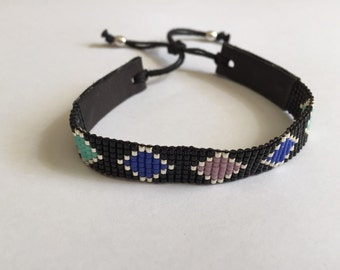 Miyuki delica bracelet with black leather.
