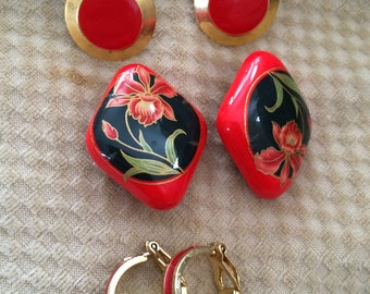 set of three vintage red clip on earrings