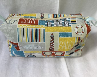 Beautiful cosmetic bag in a Sunny/holiday cotton print with water resistant lining