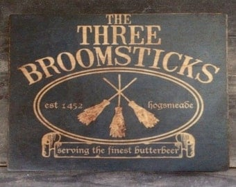 Three Broomsticks Rustic Distressed Sign