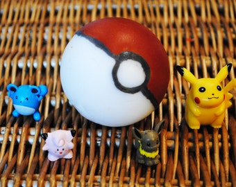 Pokeball Soap with a toy in the middle – Handmade Party Favour Anime Geek Gift