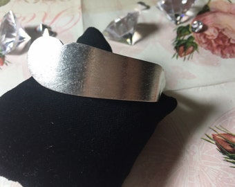 Silver bracelet from butter knife